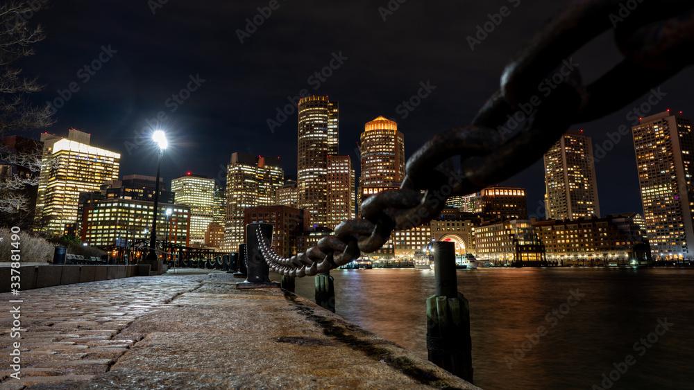 Fototapeta Boston Harbor and Financial District skyline at sunset in Boston, Massachusetts USA
