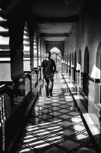Fototapety, obrazy: Man Walking In Corridor Of Building