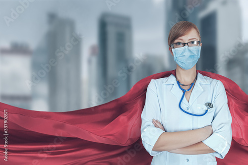 Valokuva Portrait of young medical doctor hero woman with super person red cape protect c