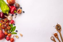 Directly Above Shot Of Fruits And Vegetables On White Background