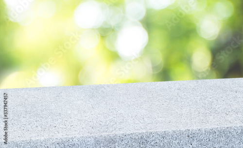 Obraz spring background.Empty diagonal pebble stone table with blur tree in garden boekh background,banner mockup template for display of product - fototapety do salonu