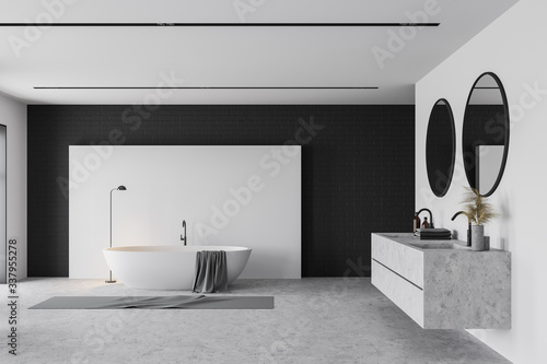 White and black bathroom interior, tub and sink