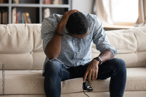 Unhappy young african american man holding joystick, feeling upset after losing xbox video game Canvas Print