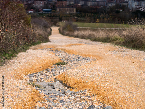 Erosioned crack on a compacted fine gravel road in Vitoria-Gasteiz, Basque Count Canvas Print