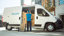 Delivery Man Uses Hand Truck T...