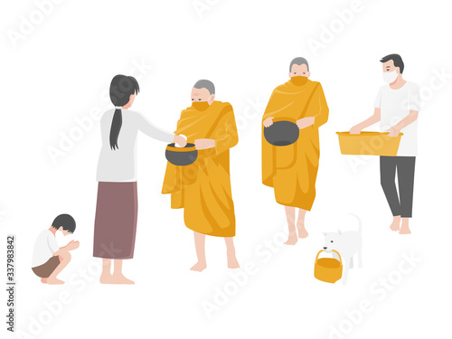 Photo Give alms, People Make merit by offering food to monks and wearing a surgical protective Medical mask for prevent Corona virus