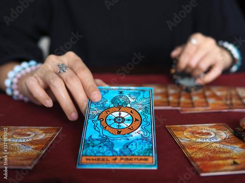 Photo tarot card reading wheel of fortune teller astrologer divination selected focus
