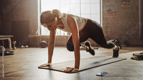 Fotografija Beautiful and Young Girl Doing Running Plank on Her Fitness Mat