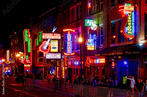 Crowd In Illuminated City At Night Wallpaper Mural