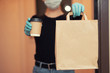canvas print picture - Food and coffee delivery cardboard boxes woman in protective mask. Quarantine coronavirus online shopping
