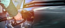 Woman Refueling At A Gas Stati...