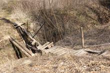Broken Wooden Bridge Across The River (Russia)