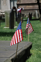 American Flags On Grassy Field During Sunny Day