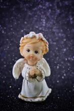 Figurine Angel With Wings On A...