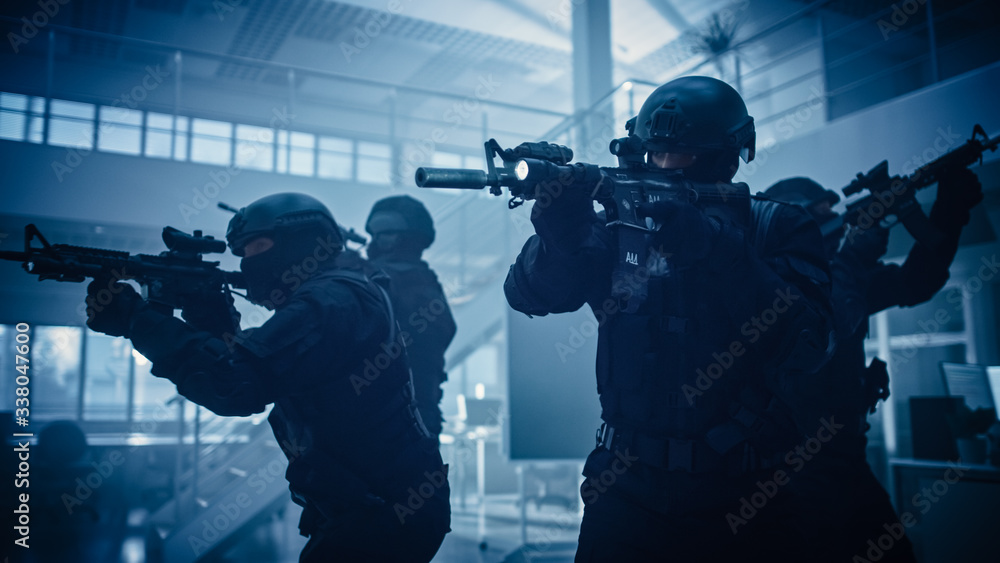 Fototapeta Close Up Portraits of Masked Squad of Armed SWAT Police Officers Storm a Dark Seized Office Building with Desks and Computers. Soldiers with Rifles and Flashlights Move Forward and Cover Surroundings.