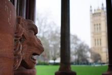 Close-up Of Lion Statue Against Building