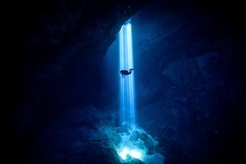 Sunlight Falling On Silhouette Person Scuba Diving Undersea