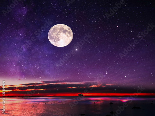 full moon on night starry sky at sea lilac pink sunset sky stars summer sea dark blue water reflection moonlight galaxy background nature