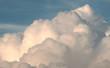 Leinwandbild Motiv white puffy clouds in the blue sky