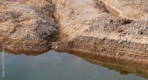 Layers of shingle and silt at a gravel pit Canvas Print