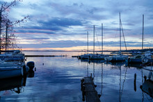 Sunrise Or Sunset On Blue Water Marina Boats In Lake Of Biscarrosse Landes France