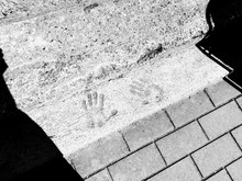 High Angle View Of Handprints On Footpath During Sunny Day