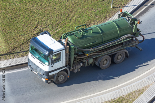 Leinwand Poster Truck with green tank for pumping waste or contaminated water.