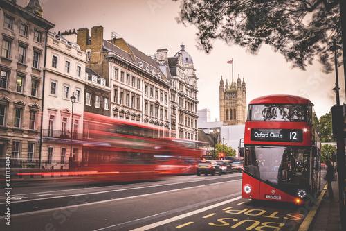 Valokuvatapetti Double-decker Bus On Road In City During Sunset