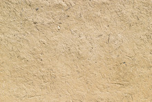 Adobe - Clay And Straw Material Weathered Wall Of Rural Old Country House Close-up As Clay Background