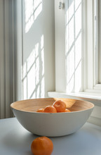 Close-up Of Oranges In Bowl On Table At Home