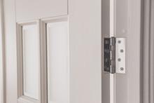 Stainless Door Mortised Hinge On A White Door