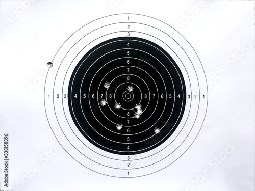Canvas Print Close-up Of Target With Bullet Shots Against White Background
