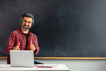 E-Learning/Online Education. Adult man teacher teaching with online at internet.