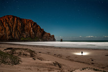 Rear View Of Man Stargazing At...