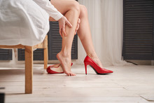 Woman Massages Tired Legs In R...