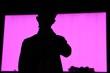 Leinwandbild Motiv Silhouette Man Standing Against Purple Wall