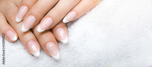 Manicure and Hands Spa. Beautiful Woman hands closeup. Manicured nails and Soft hand skin wide banner.