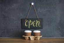 A Sign That Says Open On Cafe,...