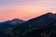 Pink Orange Sunset In Aspen, Colorado With Rocky Mountains Peak In Autumn And Vibrant Pastel Color At Twilight