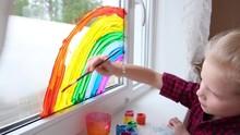 4k. Girl Painting Rainbow On W...