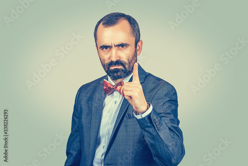 Photo serious young girl business woman showing index finger for admonition