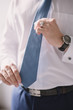 Midsection Of Businessman Holding Necktie