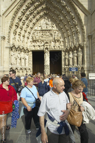 People exiting service from the Notre Dame Cathedral, Paris, France Wallpaper Mural