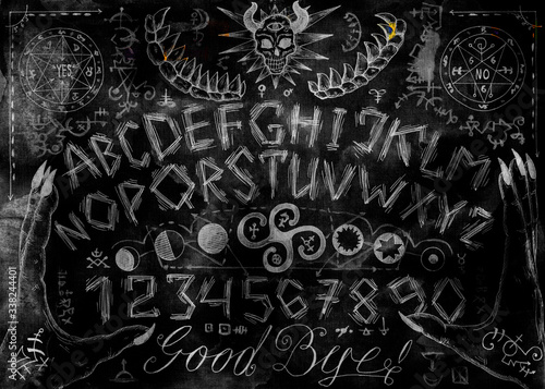 Photo Ouija magic spiritual board design with alphabet letters, hands, pentagram and evil signs