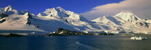 Panoramic View Of Ecological Tourists In Inflatable Zodiac Boats, Snowy Mountains, Glaciers And Icebergs At Half Moon Island, Bransfield Strait, Antarctica