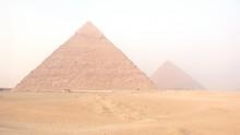Pyramids On Desert Against Clear Sky