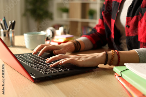 Fotografie, Obraz Student girl hand e-learning on laptop in the night at home