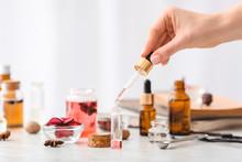 Woman Preparing Perfume On Table