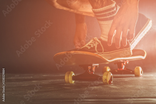 Obraz Low Section Of Man Skateboarding On Floor At Home - fototapety do salonu