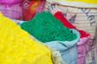 Leinwanddruck Bild - Colorful holi powder for sale at market